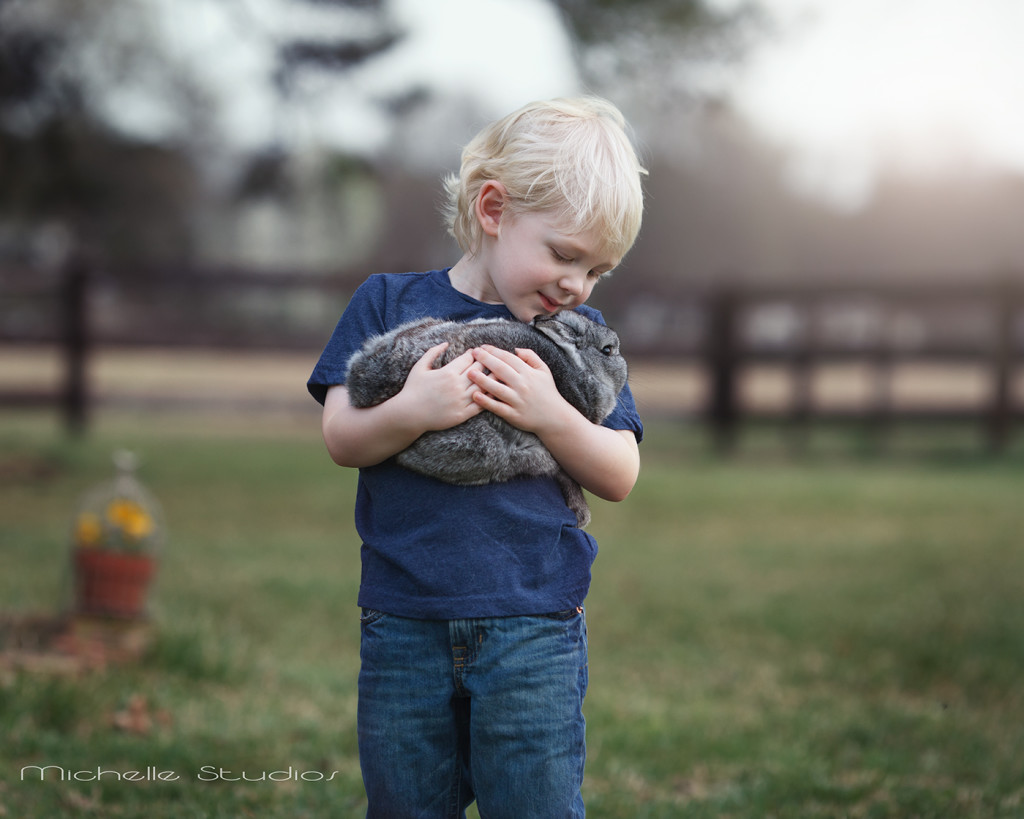 boy holding bunny like a baby Raleigh Children's Photographer